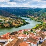 The river Guadiana and the village of Mertola. Alentejo Region